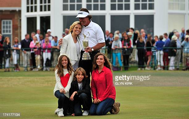 US golfer Phil Mickelson poses for pictures with his wife Amy and children Evan Samuel Amanda Brynn and Sophia Isabel after winning the 2013 British...