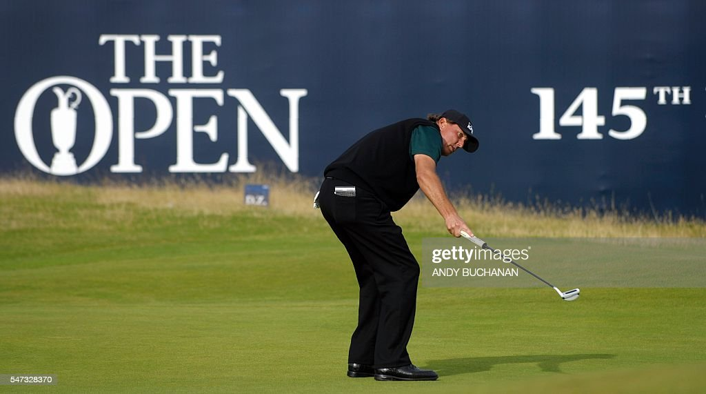 US golfer Phil Mickelson reacts as he putts on the 18th hole during his first round 63 on the opening day of the 2016 British Open Golf Championship at Royal Troon in Scotland on July 14, 2016. Former champion Phil Mickelson went clear at the top of the leaderboard at the British Open on Thursday after a stunning eight-under-par first round of 63 at Royal Troon. USE
