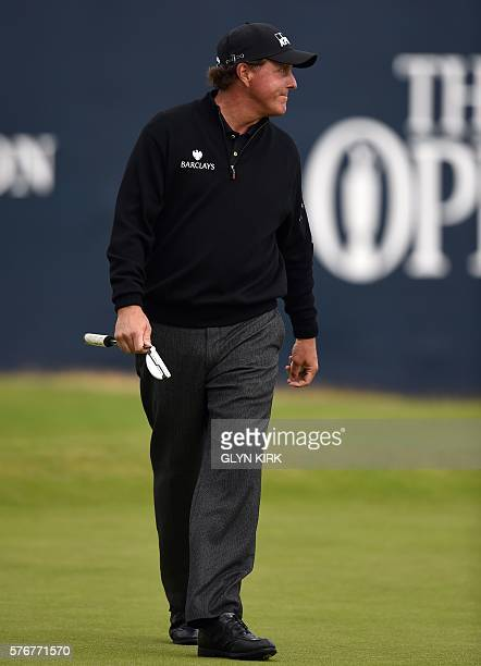 Golfer Phil Mickelson reacts on the 18th green during his final round 65 on day four of the 2016 British Open Golf Championship at Royal Troon in...