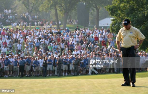 Golfer Phil Mickelson stares at the ground June 18 on the 18th green after realizing he would double-bogey to lose the U.S. Open by one stroke to...