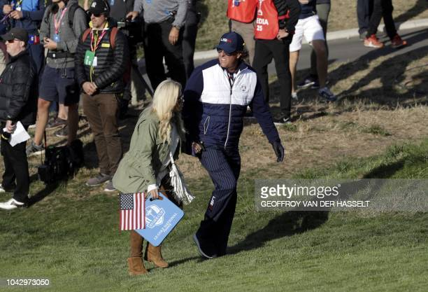 US golfer Phil Mickelson walks with his wife Amy on the second day of the 42nd Ryder Cup at Le Golf National Course at SaintQuentinenYvelines...