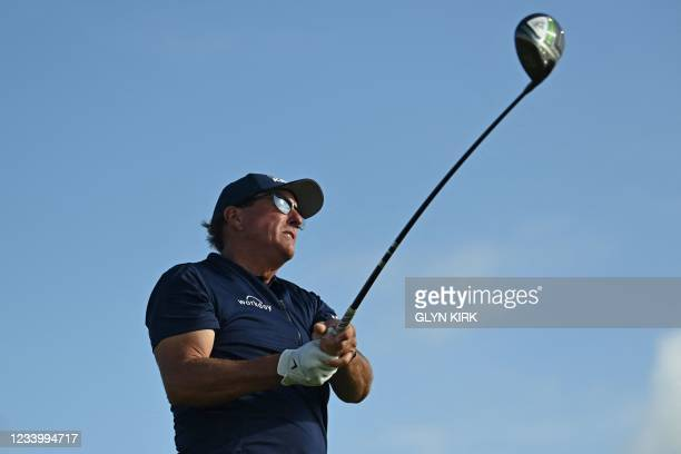 Golfer Phil Mickelson watches his drive from the 12th tee during his first round on day one of The 149th British Open Golf Championship at Royal St...