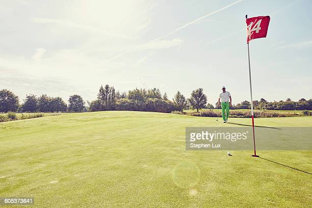 golfer playing golf, near 14th hole, korschenbroich, dusseldorf, germany - green golf course stock pictures, royalty-free photos & images