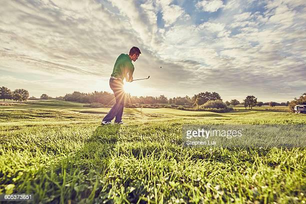 Golfer playing golf on course, Korschenbroich, Dusseldorf, Germany