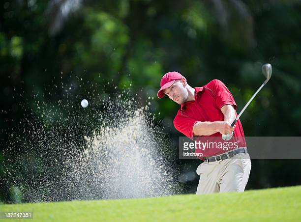 golfer playing shot - golf swing stock pictures, royalty-free photos & images
