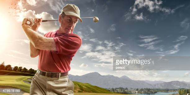 golfer portrait in mid backswing - golf swing stock pictures, royalty-free photos & images