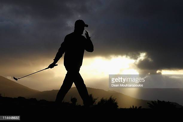 A golfer practices on the putting green as the sun rises before day two of the Madeira Islands Open on May 20 2011 in Porto Santo Island Portugal