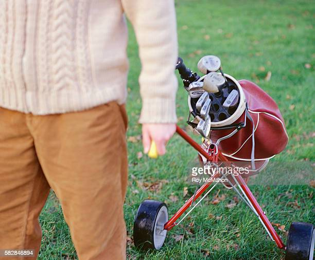 Golfer Pulling Golf Bag