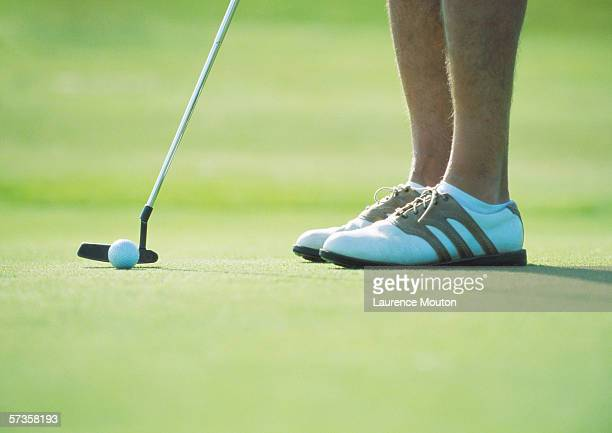 golfer putting, low section - putting stock pictures, royalty-free photos & images