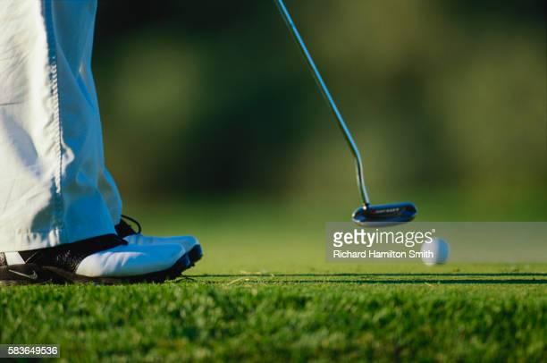 golfer putting - putting - fotografias e filmes do acervo
