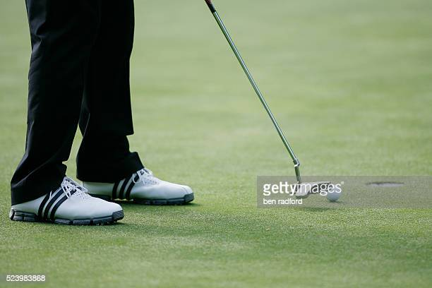 A golfer putts the ball towards the hole during the third round of the BMW PGA Championships at Wentworth Golf Club Virginia Water Surrey UK