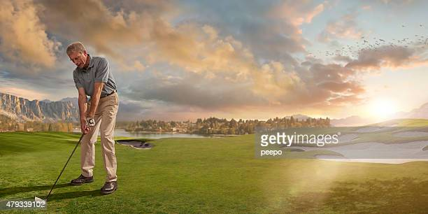 Golfer Ready to Play Shot on Course At Sunset