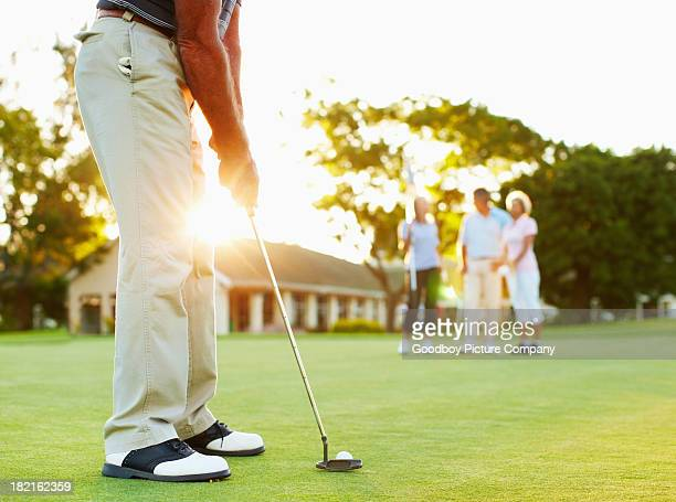 Golfer ready to putt
