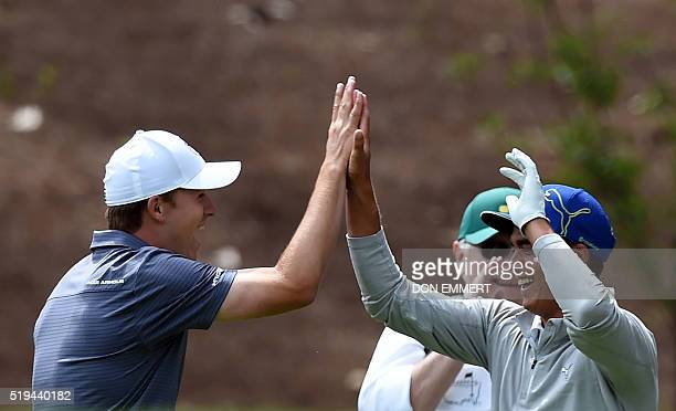 US golfer Rickie Fowler celebrates with Jordan Spieth after making hole in one on the 4th tee during the Par 3 contest prior to the start of the 80th...