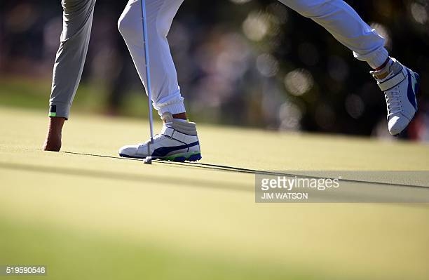 US golfer Rickie Fowler collects his ball after a putt during Round 1 of the 80th Masters Golf Tournament at the Augusta National Golf Club on April...