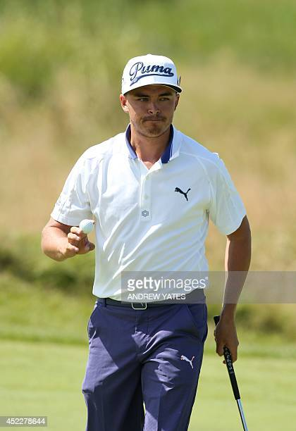 US golfer Rickie Fowler gestures on the 13th green during his first round 69 on the opening day of the 2014 British Open Golf Championship at Royal...