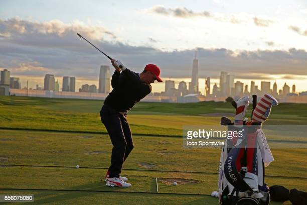 USA golfer Rickie Fowler hits balls at the practice range with the New York city skyline in the background before playing in the third round of the...