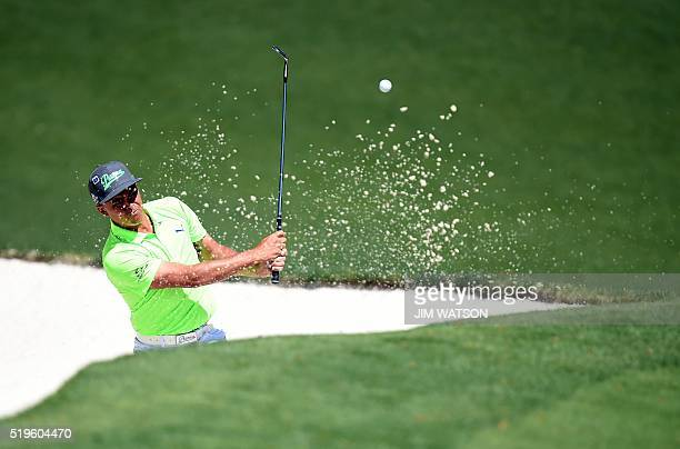 US golfer Rickie Fowler hits out of a bunker during Round 1 of the 80th Masters Golf Tournament at the Augusta National Golf Club on April 7 in...
