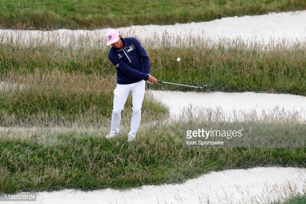 PGA golfer Rickie Fowler hits out of the rough on the 17th hole during a practice round for the 2019 US Open on June 12 at Pebble Beach Golf Links in...