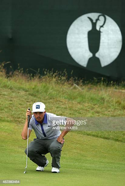 US golfer Rickie Fowler lines up a putt on the 15th green during his third round 68 on day three of the 2014 British Open Golf Championship at Royal...