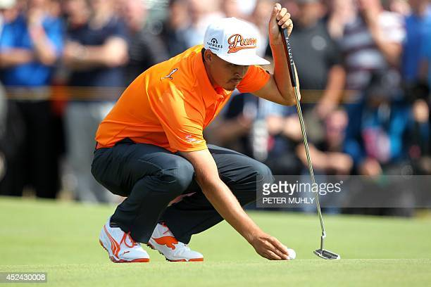 US golfer Rickie Fowler lines up a putt on the 6th green during his fourth round on the final day of the 2014 British Open Golf Championship at Royal...