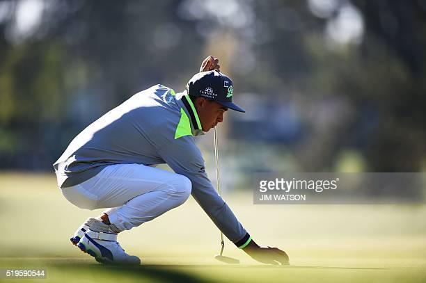 US golfer Rickie Fowler lines up a shot during Round 1 of the 80th Masters Golf Tournament at the Augusta National Golf Club on April 7 in Augusta...