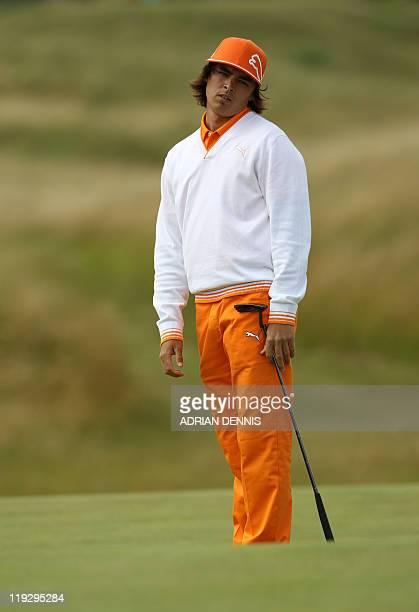 US golfer Rickie Fowler looks on on the 3rd green on the final day of the 140th British Open Golf championship at Royal St George's in Sandwich Kent...