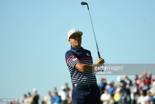 US golfer Rickie Fowler plays a fairway shot during a practice session ahead of the 42nd Ryder Cup at Le Golf National Course at...