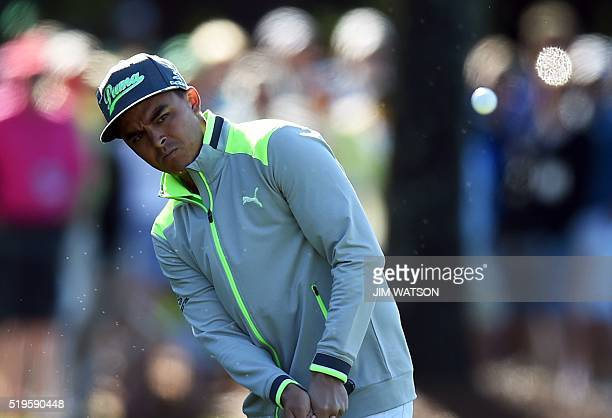 US golfer Rickie Fowler plays a shot during Round 1 of the 80th Masters Golf Tournament at the Augusta National Golf Club on April 7 in Augusta...