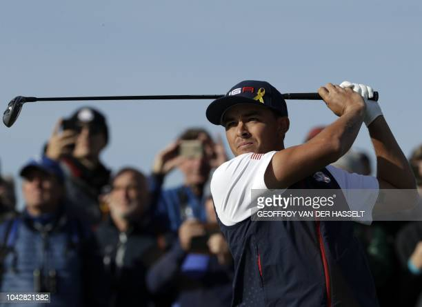 US golfer Rickie Fowler plays a tee shot during his fourball match on the second day of the 42nd Ryder Cup at Le Golf National Course at...