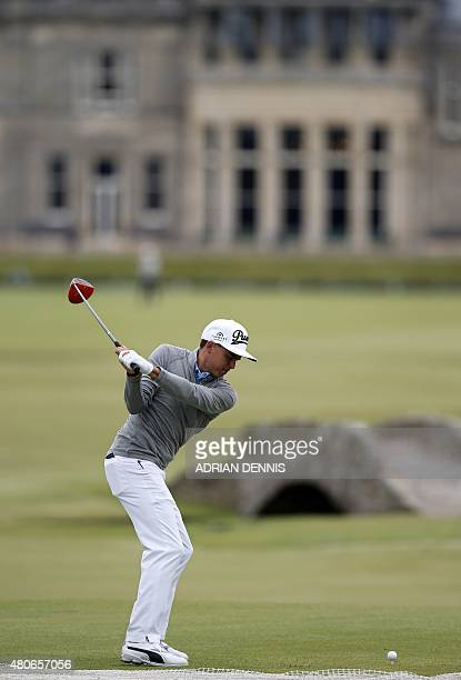 US golfer Rickie Fowler plays from the 18th tee towards the clubhouse during a practice round on The Old Course at St Andrews in Scotland on July 14...