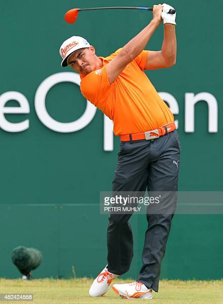 US golfer Rickie Fowler plays from the 1st tee during his fourth round on the final day of the 2014 British Open Golf Championship at Royal Liverpool...