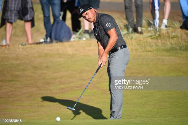US golfer Rickie Fowler putts on the 15th green during his second round on day 2 of The 147th Open golf Championship at Carnoustie Scotland on July...
