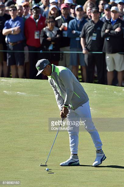 US golfer Rickie Fowler putts on the 1st hole during Round 1 of the 80th Masters Golf Tournament at the Augusta National Golf Club on April 7 in...