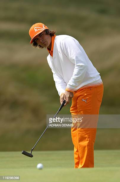 US golfer Rickie Fowler putts on the 3rd green on the final day of the 140th British Open Golf championship at Royal St George's in Sandwich Kent...