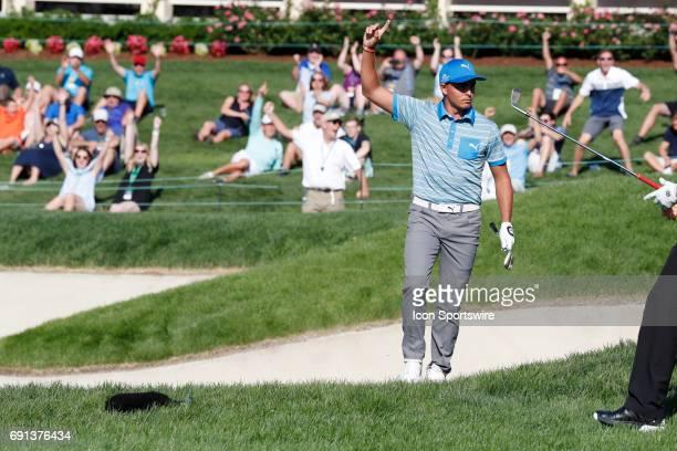 PGA golfer Rickie Fowler reacts after making a sand shot for a birdie on the 18th hole during the first round of the Memorial Tournament on June 1 at...