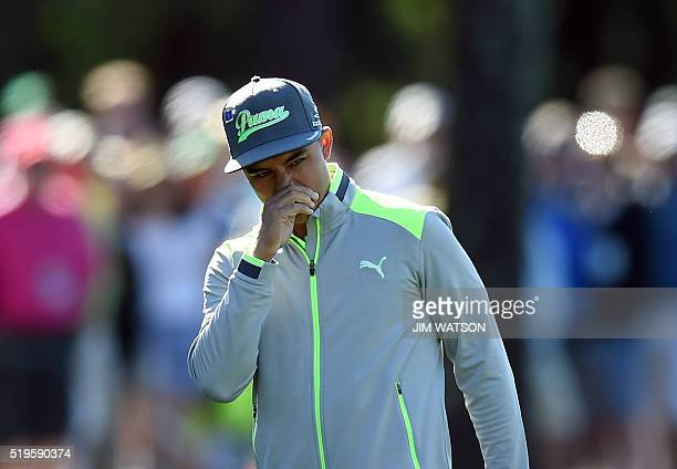 US golfer Rickie Fowler reacts after playing a shot during Round 1 of the 80th Masters Golf Tournament at the Augusta National Golf Club on April 7...
