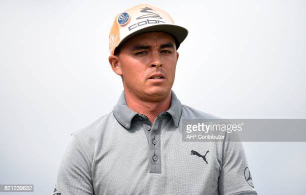 US golfer Rickie Fowler reacts after playing from the 14th tee during his final round on day four of the 2017 Open Golf Championship at Royal...
