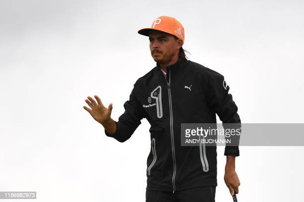 US golfer Rickie Fowler reacts after putting at the 3rd green during the final round of the British Open golf Championships at Royal Portrush golf...