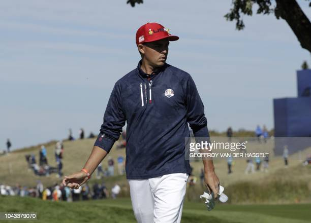 US golfer Rickie Fowler reacts during his singles match against Europe's Spanish golfer Sergio Garcia on the third day of the 42nd Ryder Cup at Le...