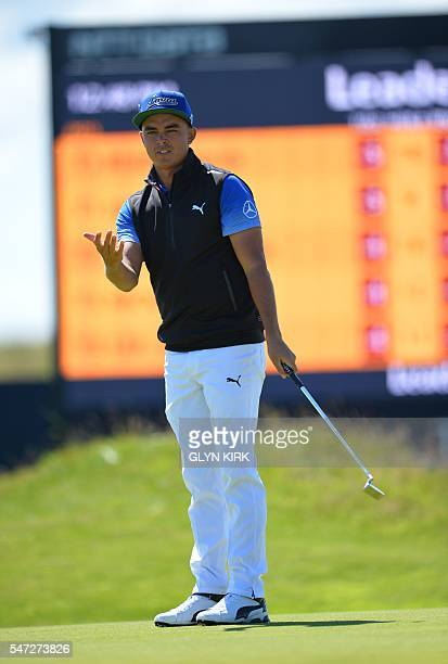 US golfer Rickie Fowler reacts on the 13th Green during his first round 69 on the opening day of the 2016 British Open Golf Championship at Royal...