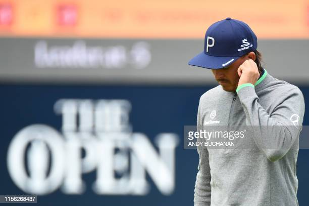 US golfer Rickie Fowler reacts on the 8th green during the first round of the British Open golf Championships at Royal Portrush golf club in Northern...