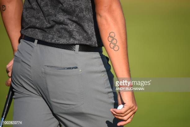 US golfer Rickie Fowler shows off his Olympic rings tattoo during his second round on day 2 of The 147th Open golf Championship at Carnoustie...