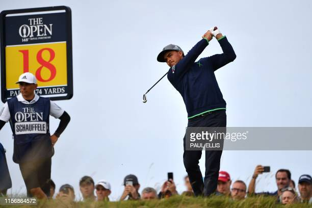 US golfer Rickie Fowler tees off at the 18th hole during the third round of the British Open golf Championships at Royal Portrush golf club in...
