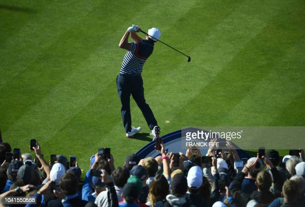 TOPSHOT US golfer Rickie Fowler tees off during a practice session ahead of the 42nd Ryder Cup at Le Golf National Course at SaintQuentinenYvelines...