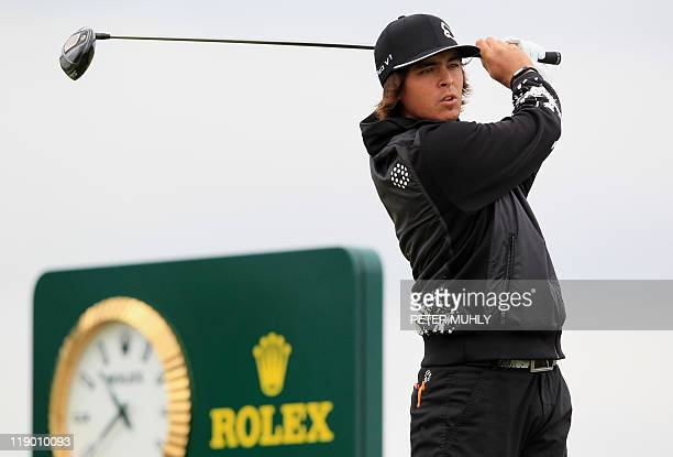 US golfer Rickie Fowler tees off from the 7th Tee on the first day of the 140th British Open Golf championship at Royal St George's in Sandwich Kent...