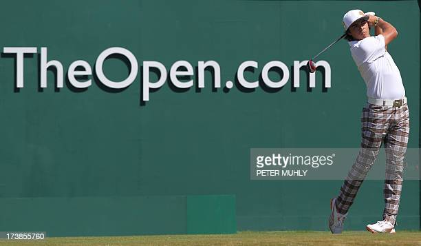US golfer Rickie Fowler tees off on the first during the first round of the 2013 British Open Golf Championship at Muirfield golf course at Gullane...