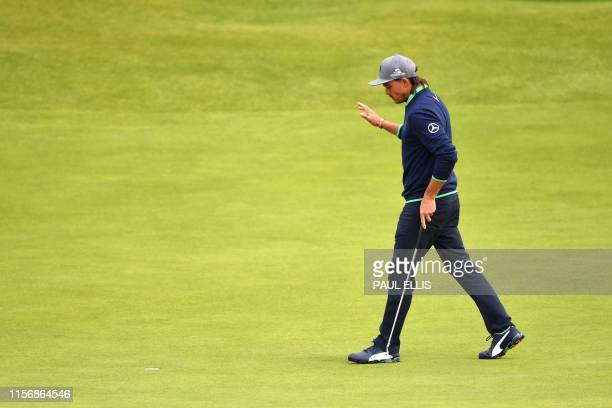 US golfer Rickie Fowler walks on the 17th green during the third round of the British Open golf Championships at Royal Portrush golf club in Northern...