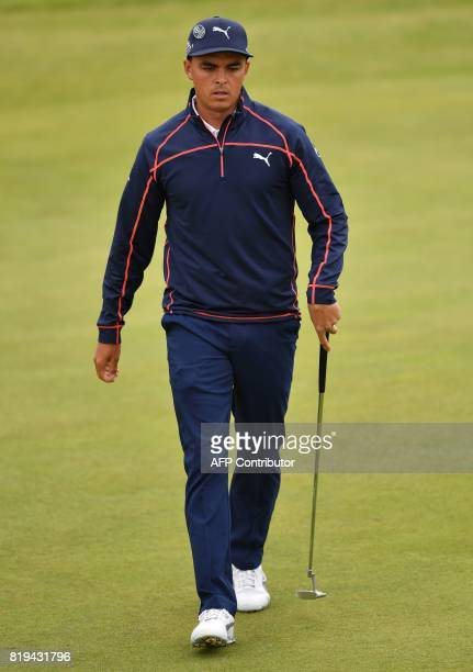 US golfer Rickie Fowler walks on the 2nd green during his opening round on the first day of the Open Golf Championship at Royal Birkdale golf course...