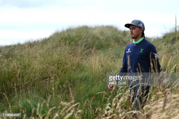 US golfer Rickie Fowler walks toward the 18th hole during the third round of the British Open golf Championships at Royal Portrush golf club in...